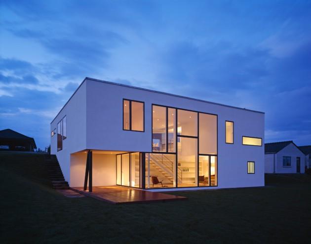 Modelo de casa moderna em formato de cubo.