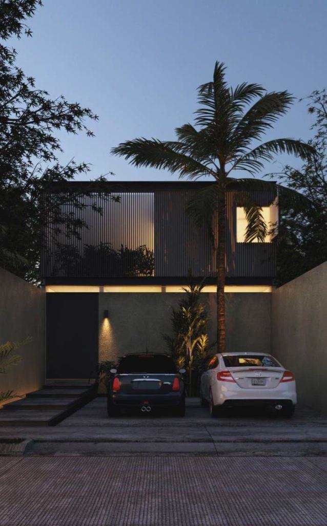 Casa de dois andares com fachada preta.