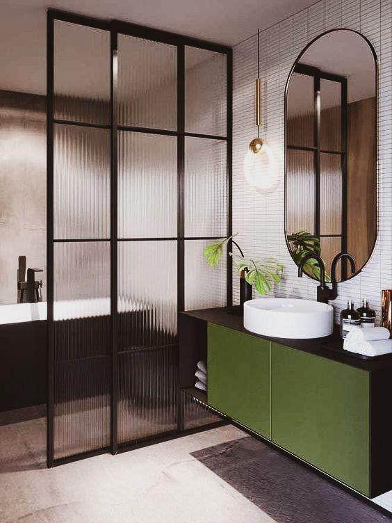 Paleta composta por preto, verde e branco para o banheiro.
