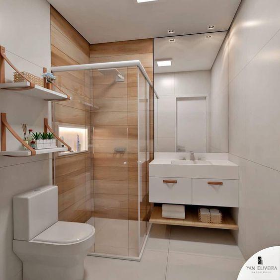 Prateleira com mão-francesa invertida deixa o banheiro mais moderno.
