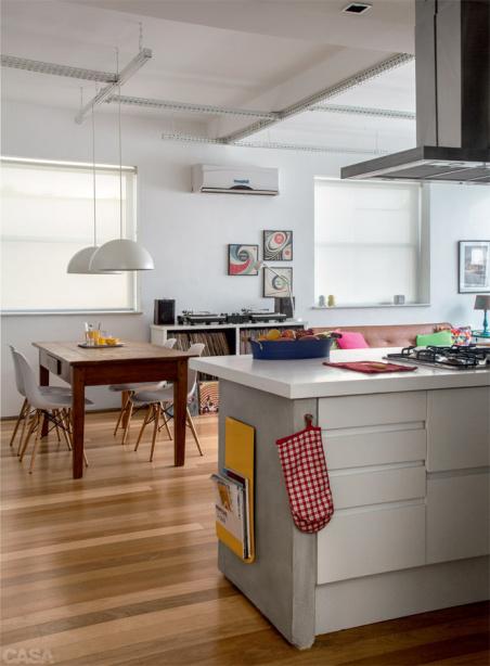 Ilhas servem como divisórias de ambientes em cozinhas modernas.