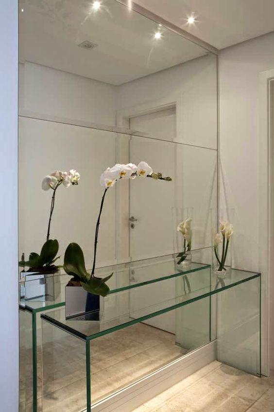 espelho bisotado em hall clean