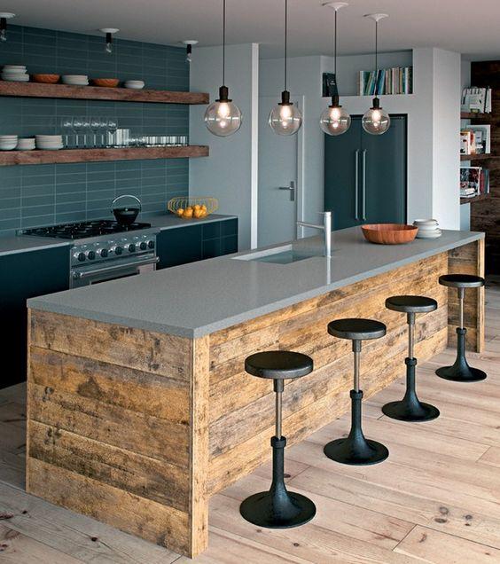 espaços gourmet com ilha presente.