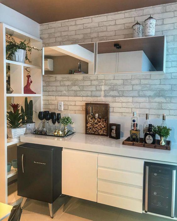 espaço gourmet com decoração em tijolos