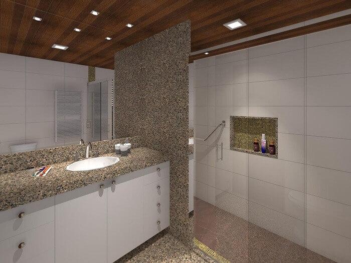 Granito cinza usado em pia e parede do chuveiro.