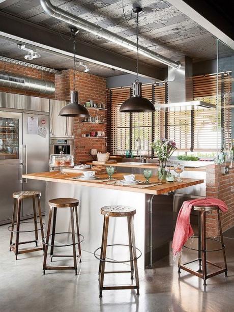 Cozinha com decoração industrial.