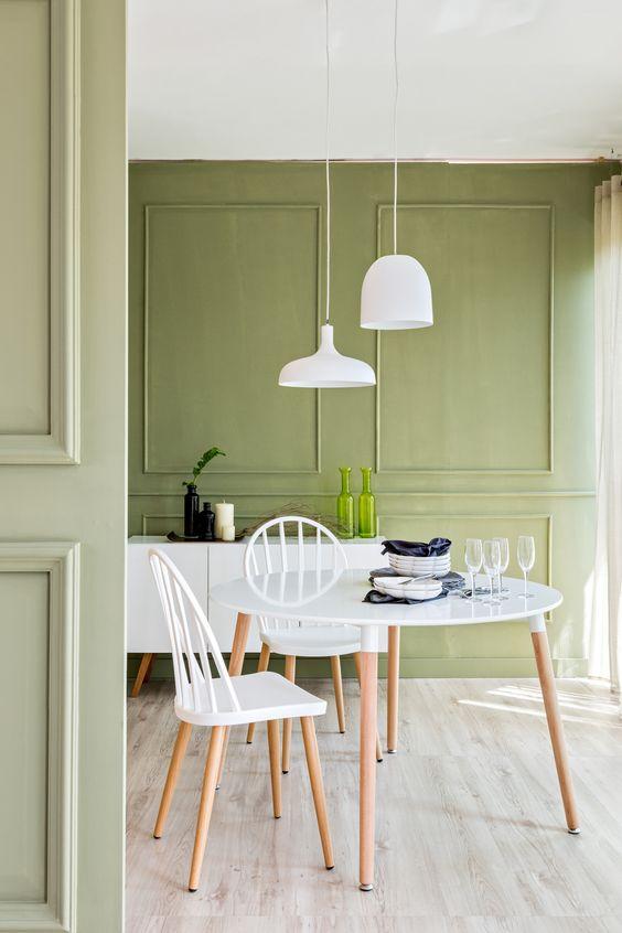 Verde-oliva é o tom principal na composição.