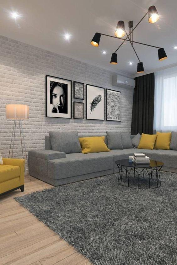 Sala moderna com tijolinho aparente.