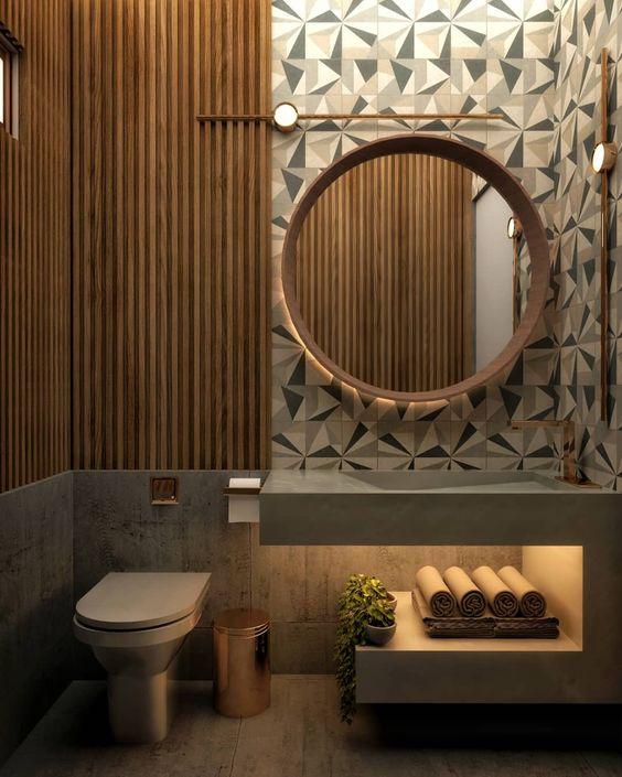 Banheiro pequeno em tons sóbrios.