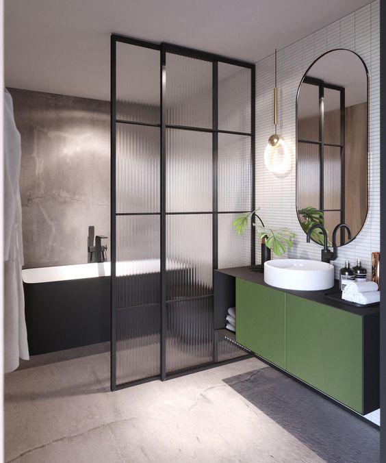 Banheiro no estilo industrial. O gabinete na cor verde oliva é o diferencial.