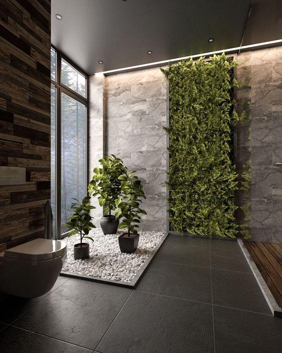 Design moderno utilizando diversos revestimentos e plantas na parede.