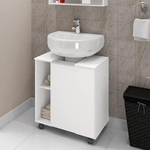 Pia branca simples em meia cuba acoplada com armário na mesma cor.