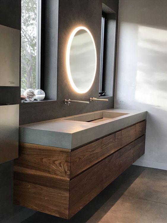 Banheiro decorado com uma cuba grande e duas torneiras.