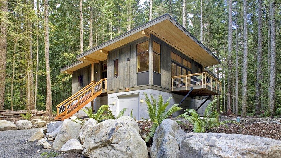 Casa no meio de uma floresta.