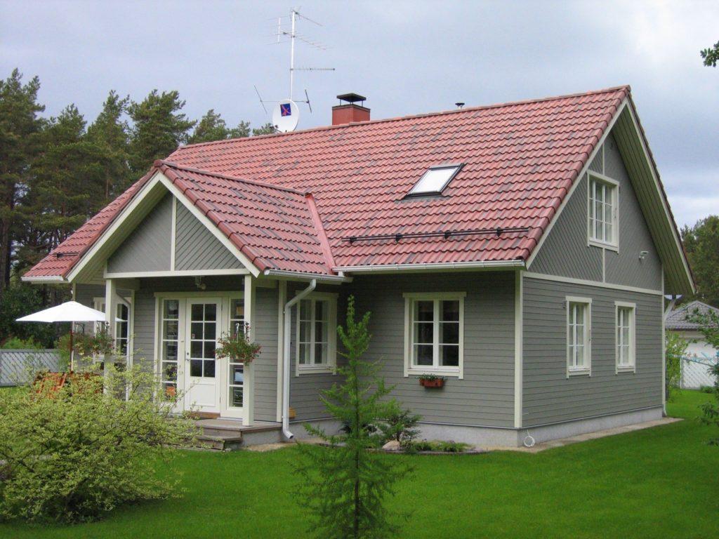 Pintura neutra marca casa de madeira.
