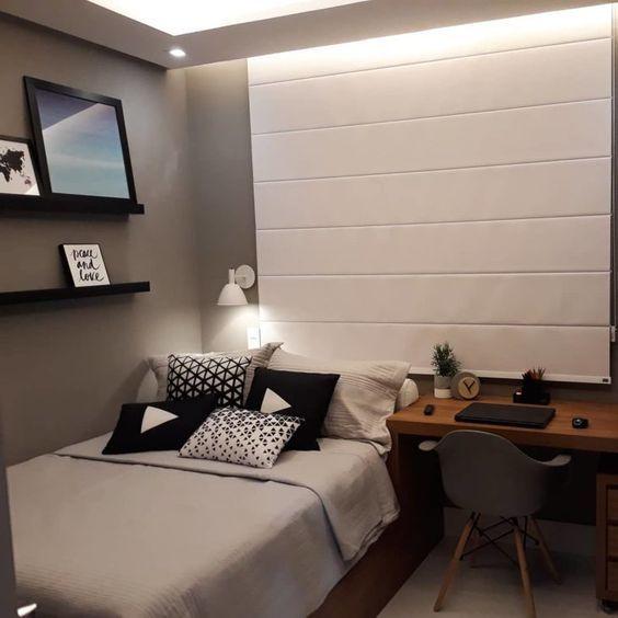 Decoração de apartamento pequeno com quarto de casal em preto, cinza e branco.