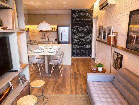 Decoração de apartamento pequeno com sala, cozinha e sala de jantar integrados.