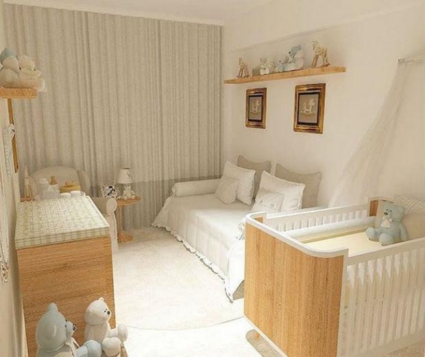 Quarto de bebê com cama, armário, berço e poltrona com cores neutras.