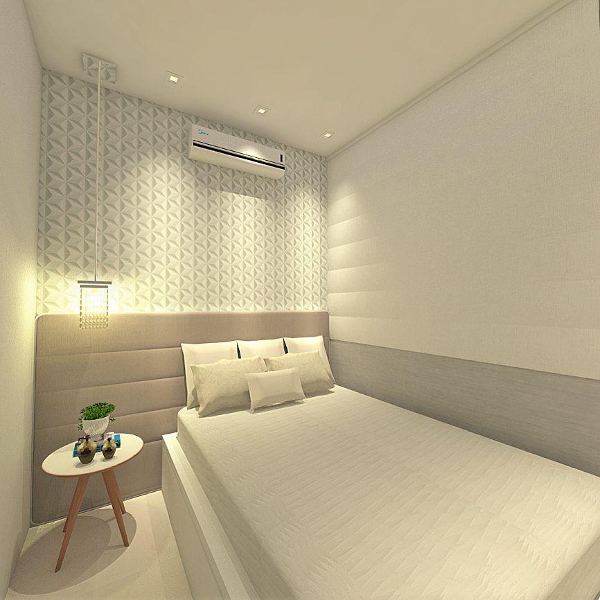 Decoração de quarto com papel de parede e luminária suspensa.