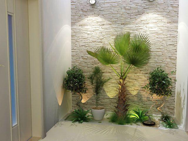 Jardim pequeno com plantas em vaso.