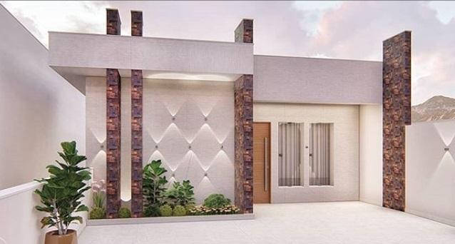 Fachada de casa com detalhes em pedra ferro.