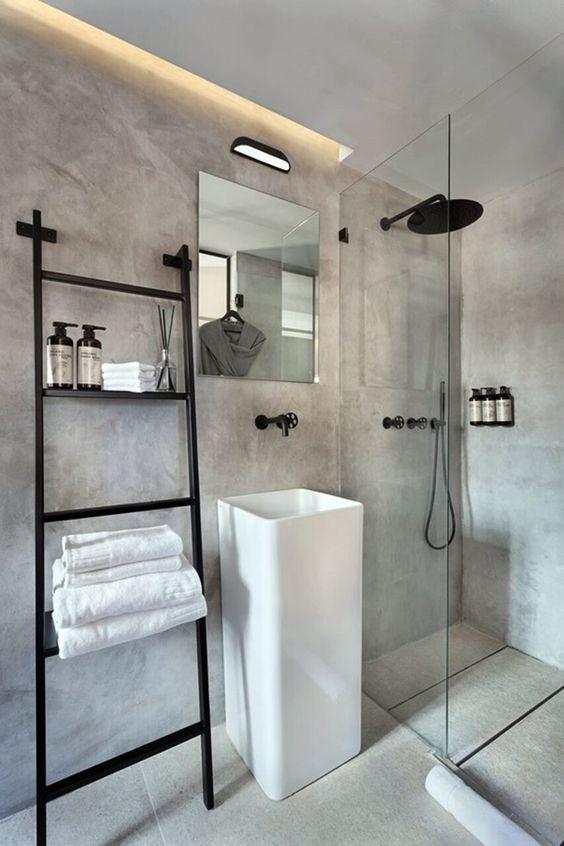 Banheiro masculino em cimento queimado