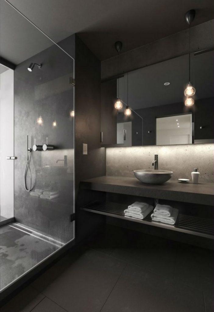 Banheiro preto com pontos focados de iluminação