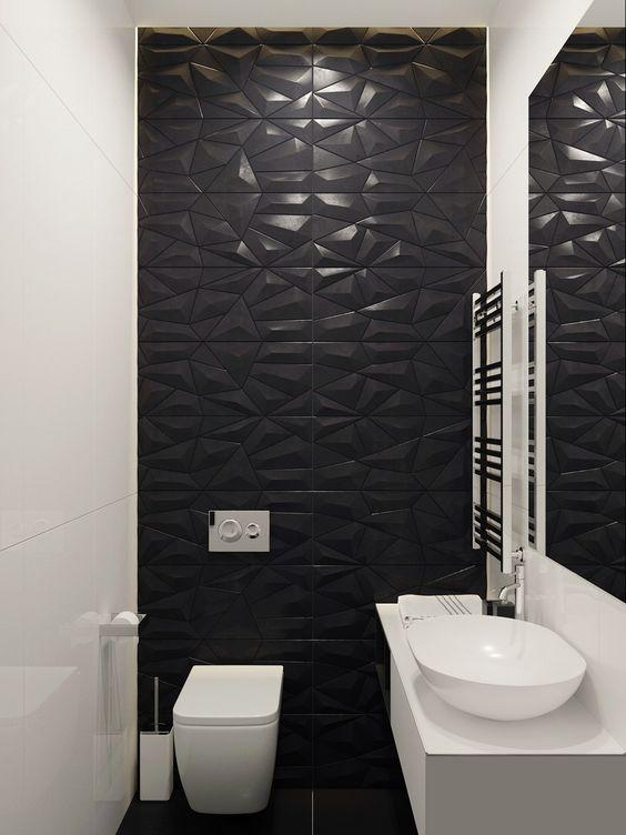 Lavabo com parede atrás do vaso preta com textura.