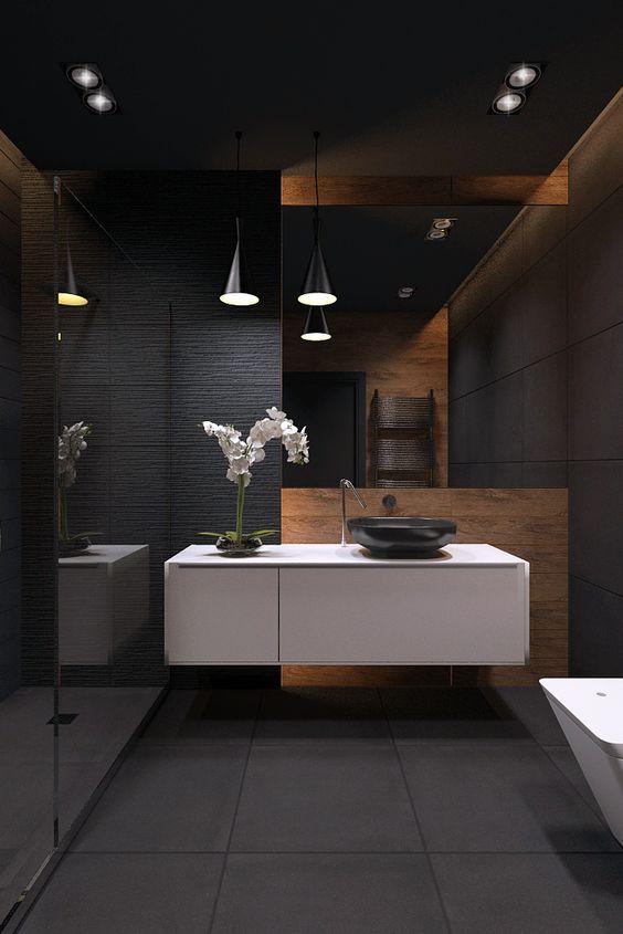 Banheiro masculino decorado em grafite e madeira