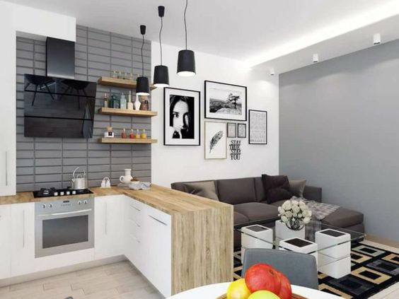 cozinha americana moderna em cinza e madeira clara