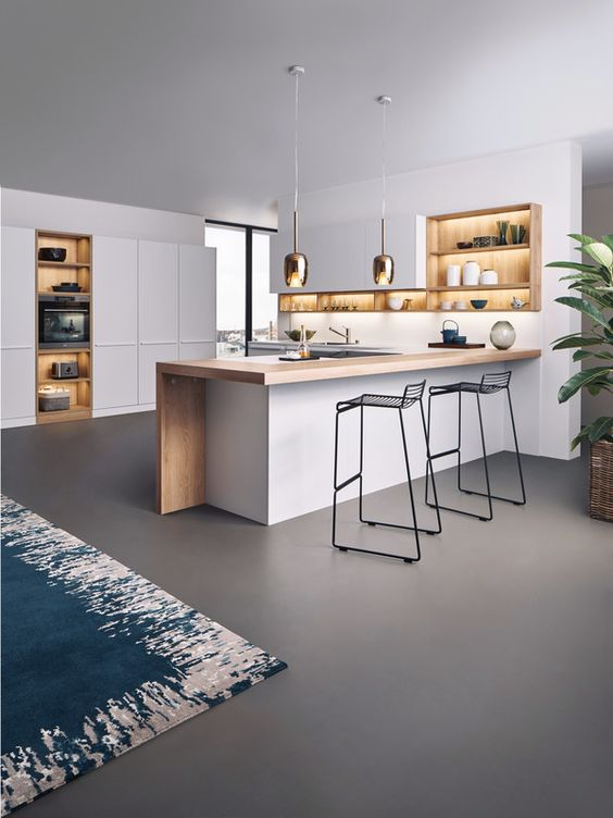 cozinha minimalista integrada com a sala