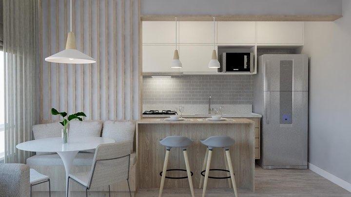 Decoração simples com armários branco e acabamento de madeira.