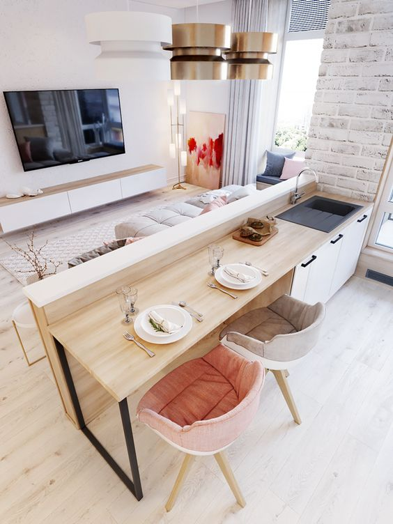 cozinha americana com sala de estar integrada e parede de tijolinhos brancos