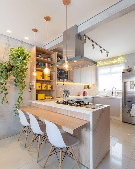 cozinha americana moderna com península de pedra