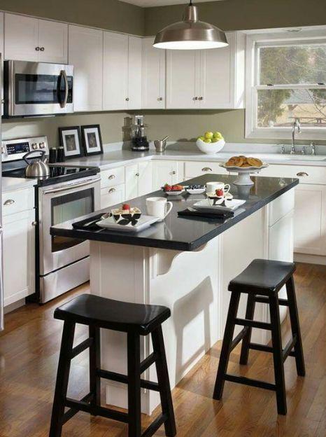 cozinha americana com ilha de granito preto