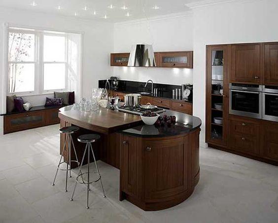 Apoio central de cozinha com espaço vazado para duas banquetas.