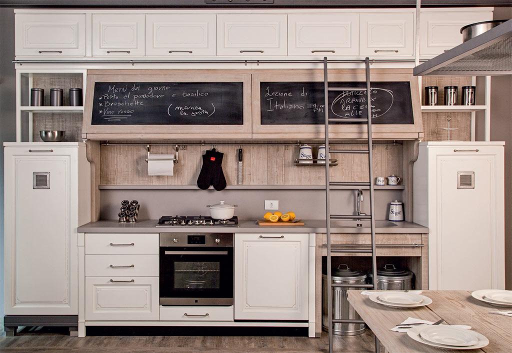 Cozinha gourmet com cookptop e forno embutidos na mesma bancada que a pia.