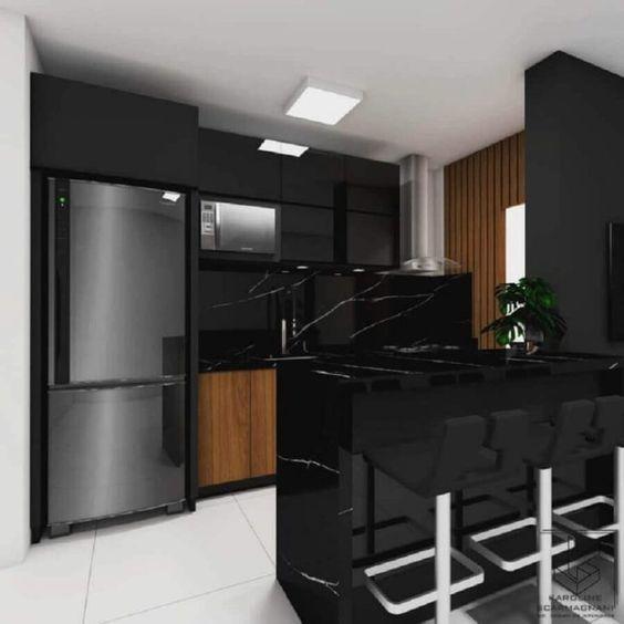 mármore preto e geladeira inox