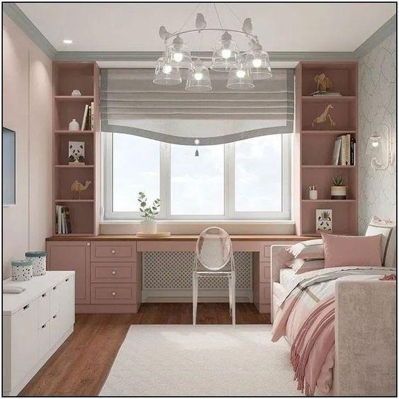 quarto feminino rosa com escrivaninha e penteadeira.