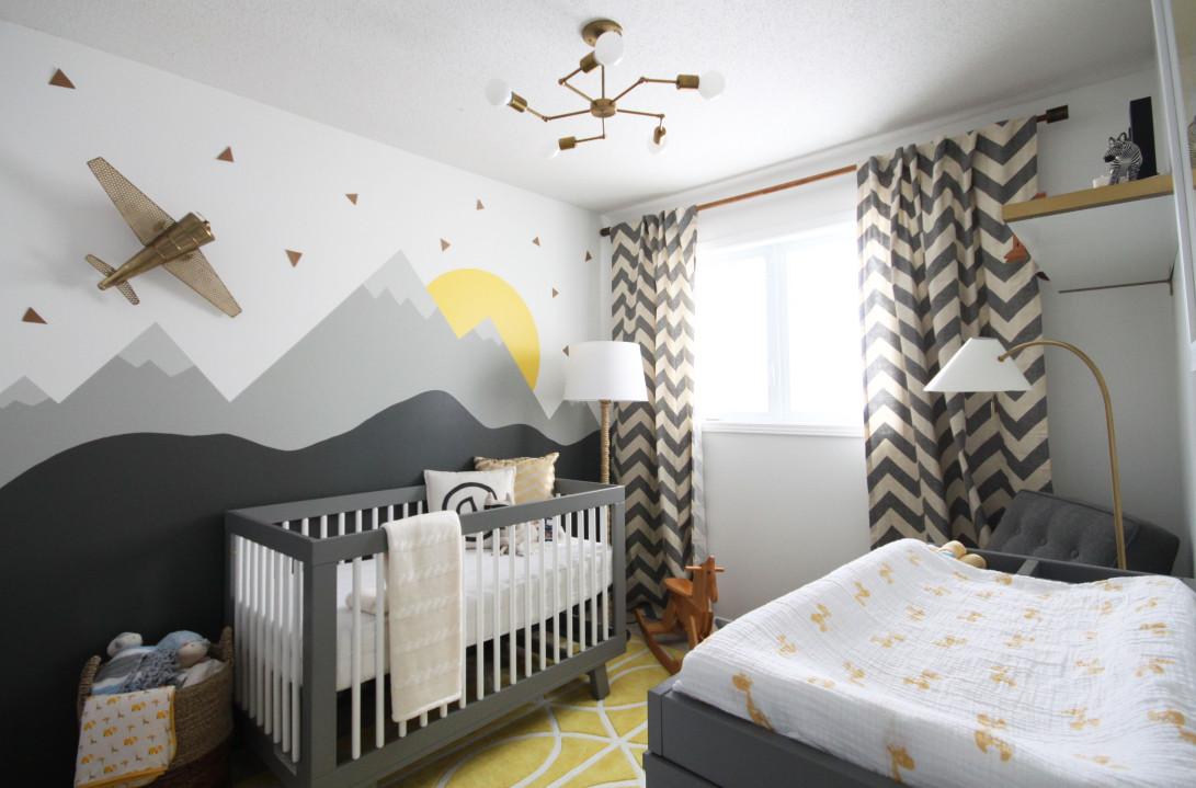 quarto de bebê menino com papel de parde de montanhas cinza e branco