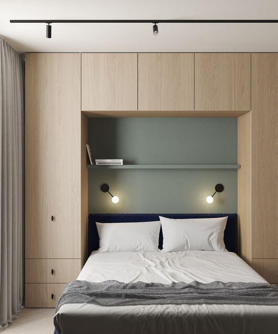 Quarto de casal planejado com decoração simples e minimalista.
