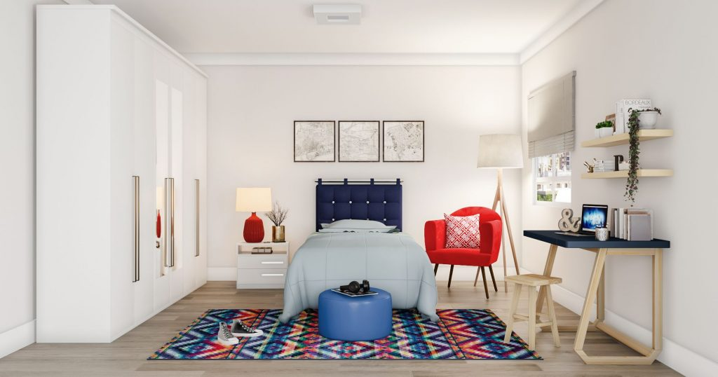 Quarto amplo com decoração branco, vermelho e azul.