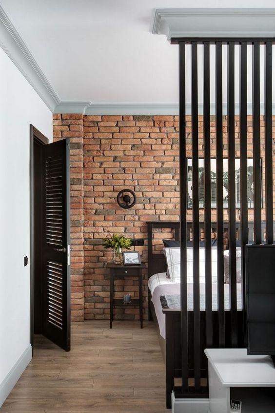 quarto industrial com tijolo aparente