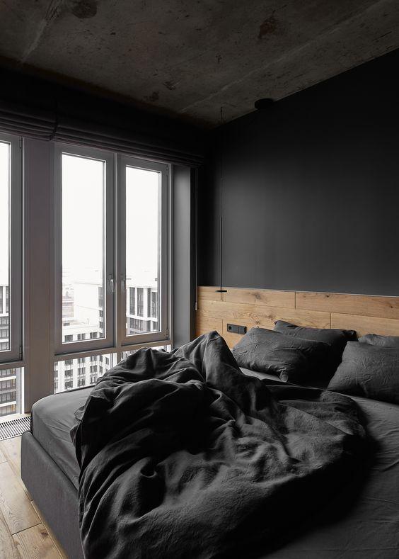 quarto moderno masculino preto com cabeceira de madeira