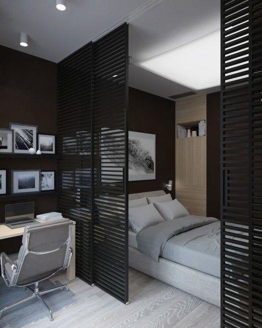 quarto masculino com painel vazado de madeira