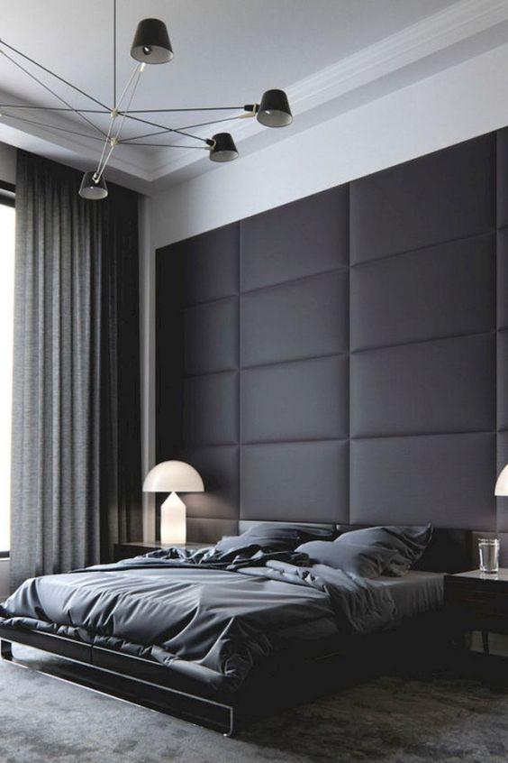 quarto masculino com grande cabeceira preta