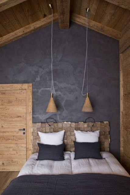 quarto com parede preta rústica e cadeceira artesenal