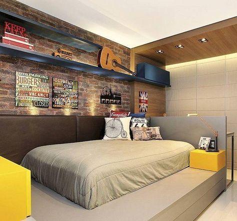 quarto masculino com parede de tijolinho e marcenaria