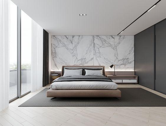 quarto minimalista masculino com parede de mármore