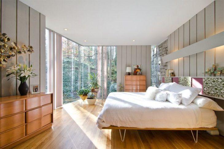 Decoração com cama com design moderno.